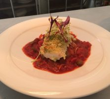 basil & parmesan crusted haddock fillet on a tomato ragout