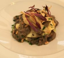 open ravioli with mushroom ragout, pine nuts & basil oil