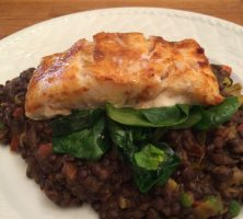 Pan fried cod with spinach and lentils