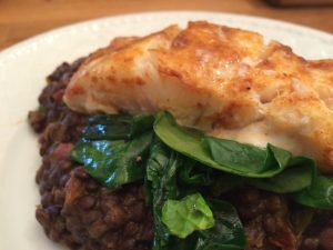 Pan Fried Cod with Wilted Spinach on Lentils