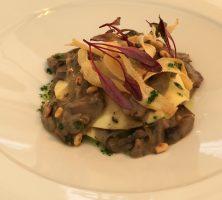 open ravioli with mushroom ragout, pine nuts & basil oil