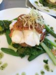 Cod topped with a basil, parmesan & chorizo crust on crushed new potatoes & summer greens